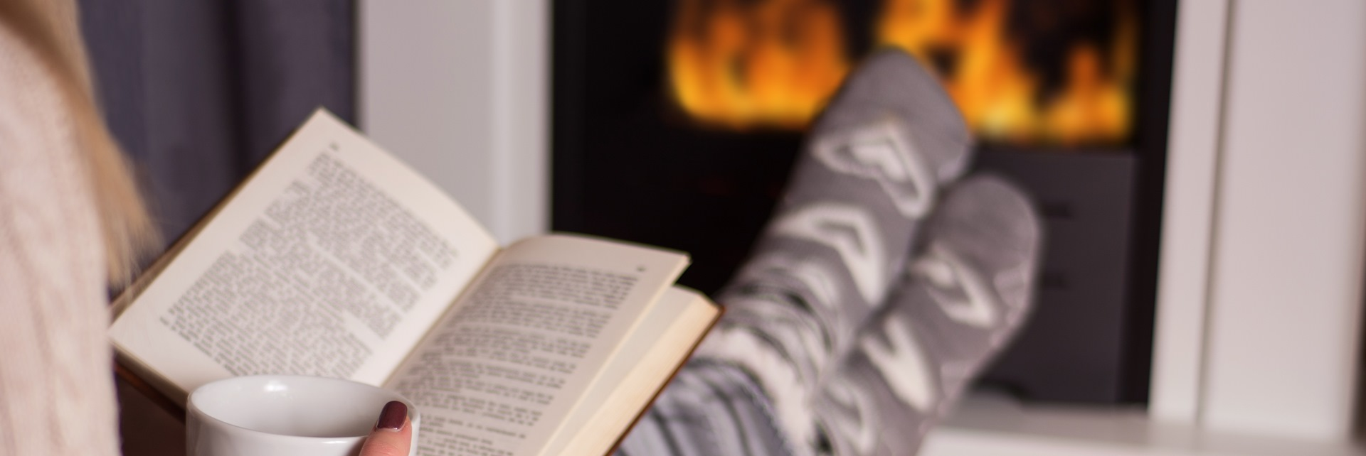 Cosy fireplace reading book