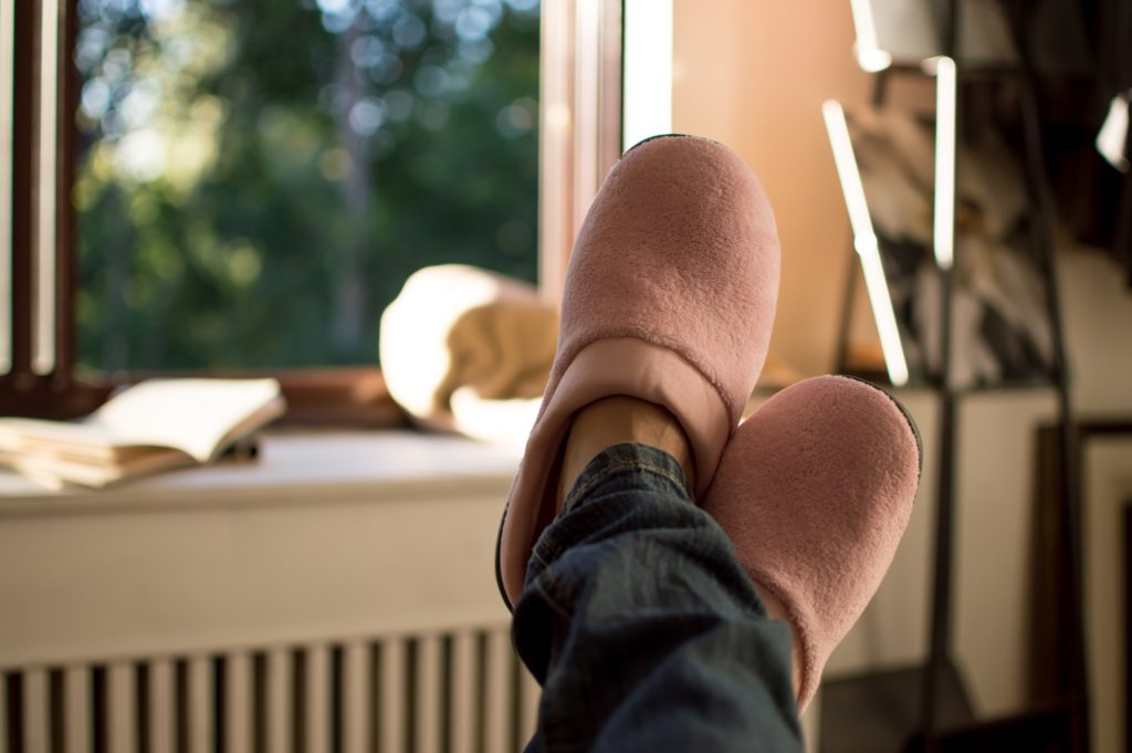 Woman wearing pink slippers 1